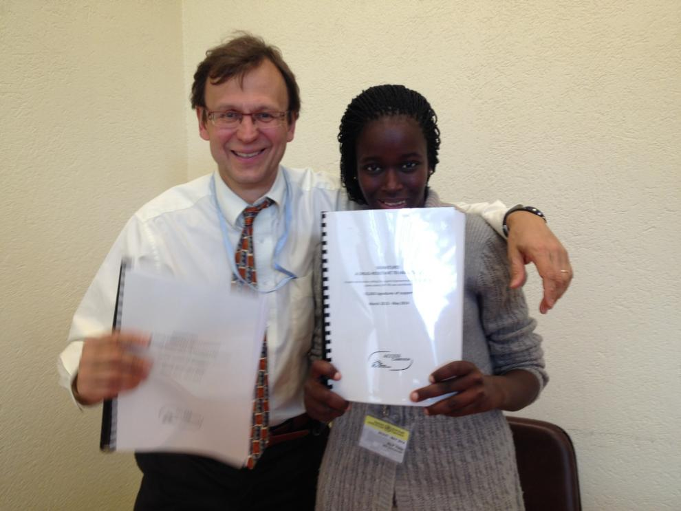 Phumeza Tisile holds the tuberculosis petition with Dr. Mario Raviglione