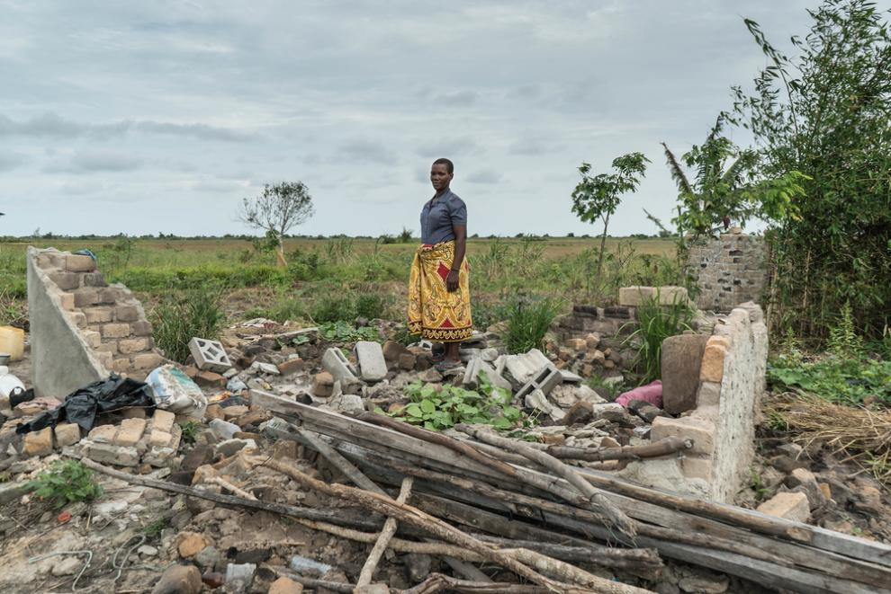 Maria Pedro, who survived Cyclone Idai, standing in what's left of her house