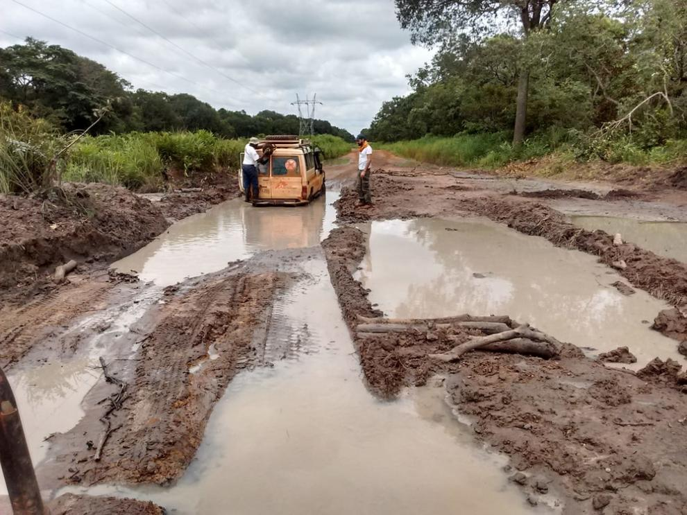 An MSF land cruiser negotiates a flooded road in the DRC