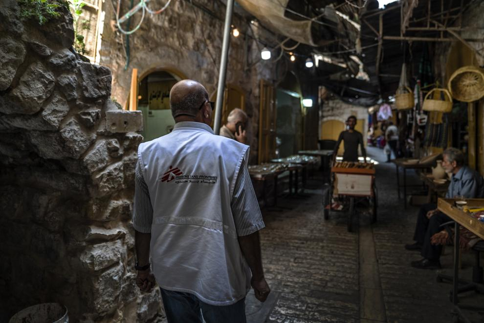 An MSF mental health specialist, who has supported families for nearly 20 years, walks to meet patients in Hebron
