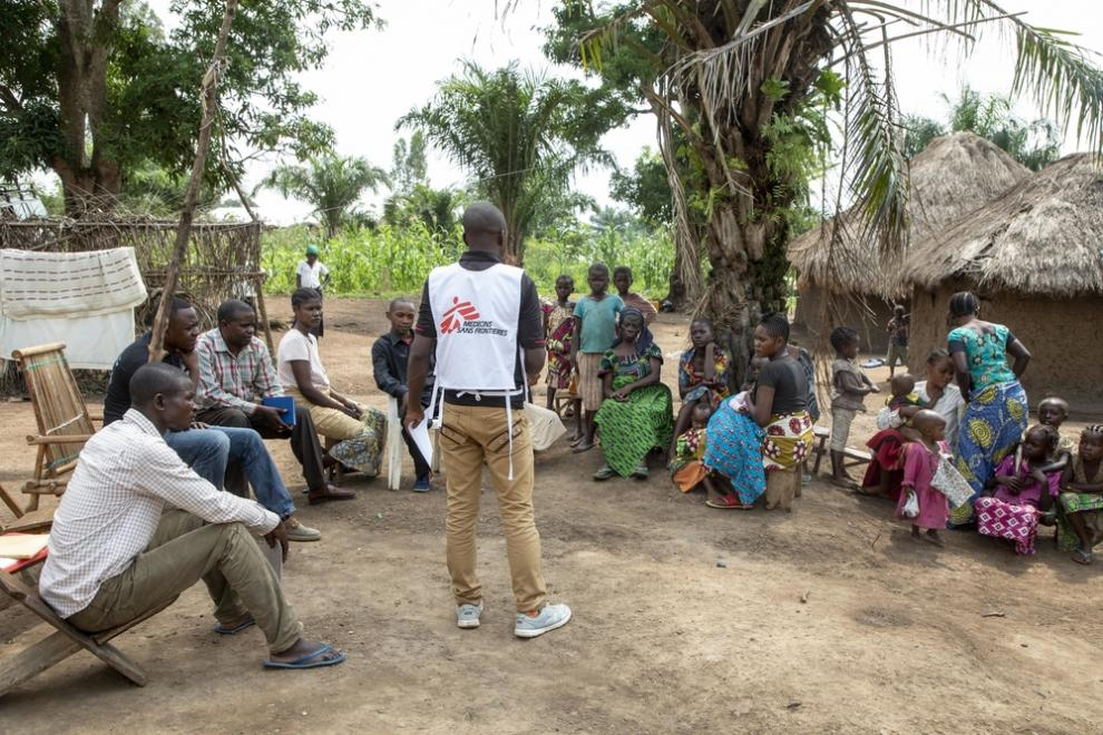 An MSF health promotion team visiting a community to raise awareness about Ebola and build a better relationship between people and health workers