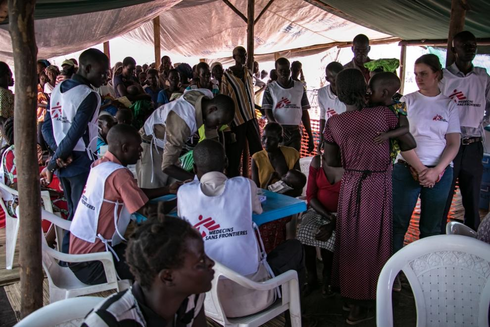 A crowded tent serves as an MSF clinic