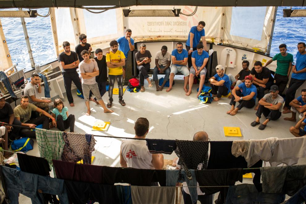 The MSF cultural mediator and logistician welcome rescued people on board the Aquarius