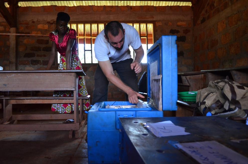 "MSF logistician Julien Devos prepares a ""cold chain"" cool box in the Central African Republic"