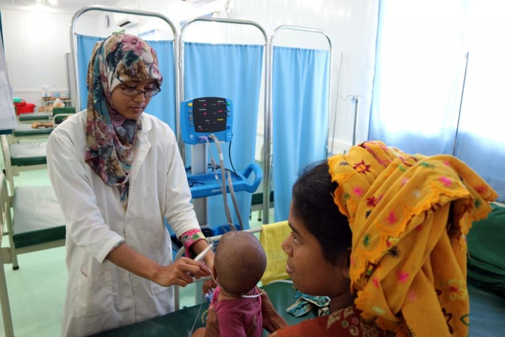 A nurse treats a five-month-old for pneumonia at the MSF hospital in Kutupalong