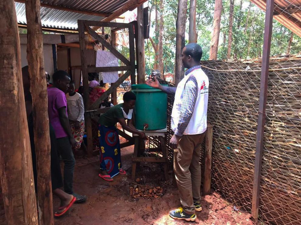 MSF health promoters teach people the recommended handwashing protocols needed to prevent the spread of COVID-19 in Nduta refugee camp.