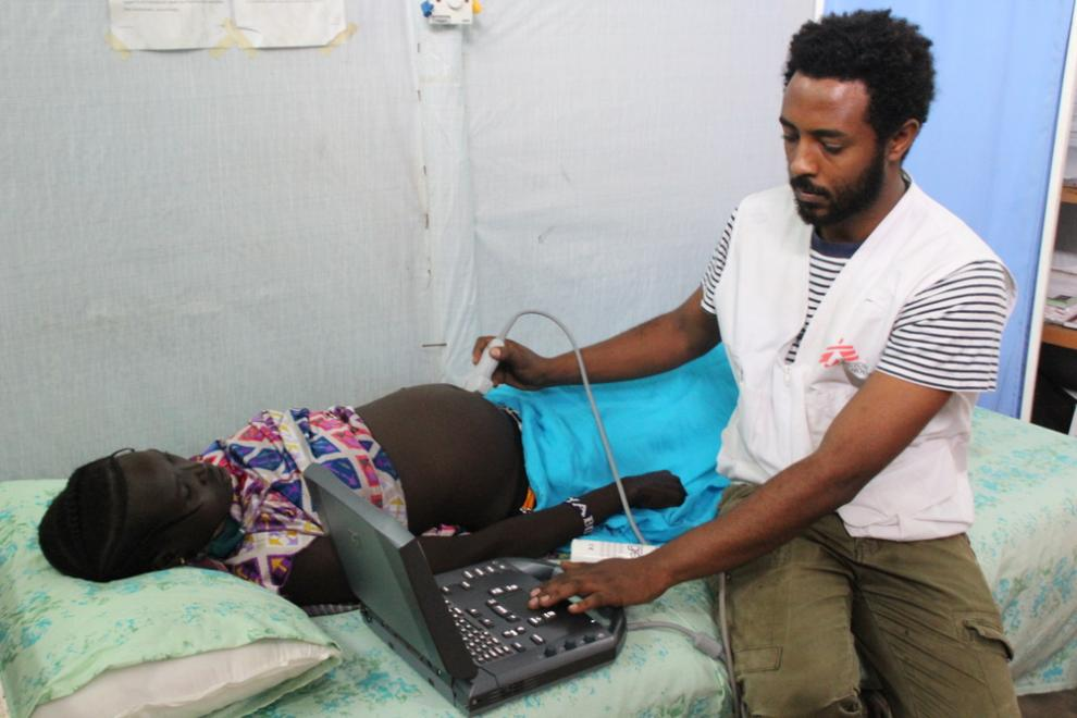 An MSF midwife performs an ultrasound scan on pregnant patient at Kule health centre