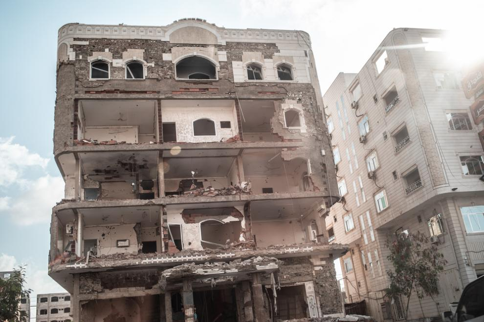 A building destroyed by fighting in the city of Aden, Yemen