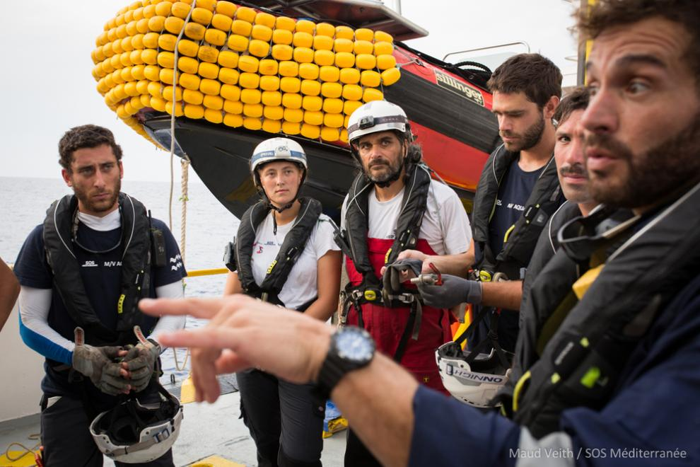 Rescue crew members on board the Aquarius