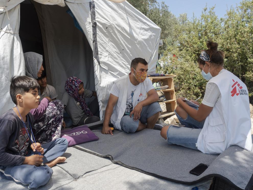 MSF staff speaking with a family from Afghanistan, still separated from two of their children who became lost while trying to reach Greece in 2018