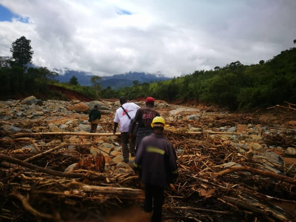 An MSF team walk on foot to access a village cut off by damage caused by Cylone idai in Chimanimani.