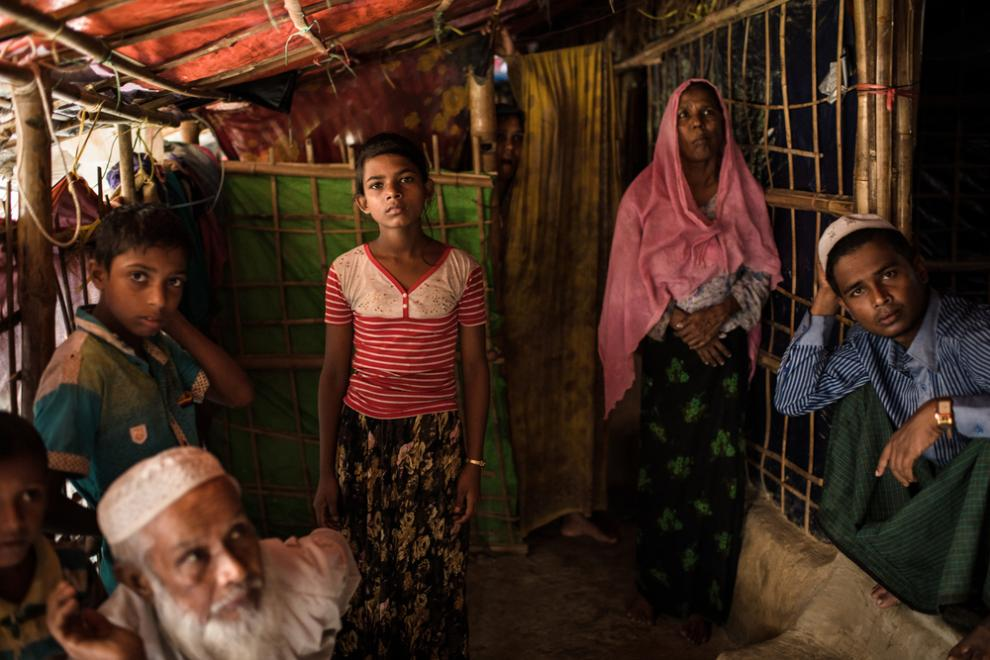Rohingya refugee Johura Begum, 12, and her brother Hyrul Amin, 10, live with their aunt and uncle in a refugee camp in Bangladesh. They are the sole survivors of their family of 16 – the rest were killed by the Myanmar military. Photo taken in August 2018