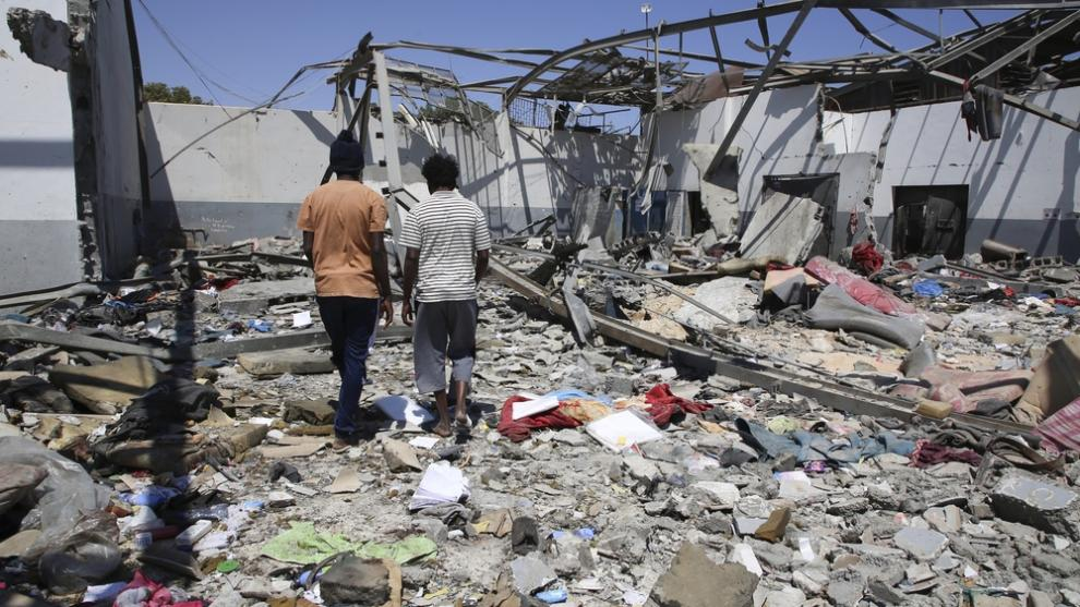 Debris covers the ground after an airstrike at the Tajoura detention centre on 3 July 2019
