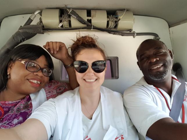 Kimberly (left), head of transfers, Brigitte (centre) and Yves-Marc (right), a driver for MSF, during the last transfer for CRUO.
