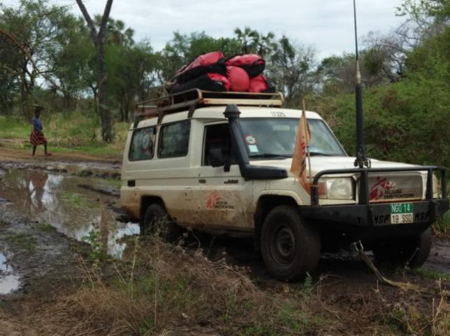 An MSF vehicle navigates the thick mud