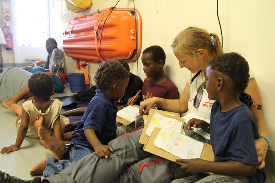 Antonia reads with some rescued children