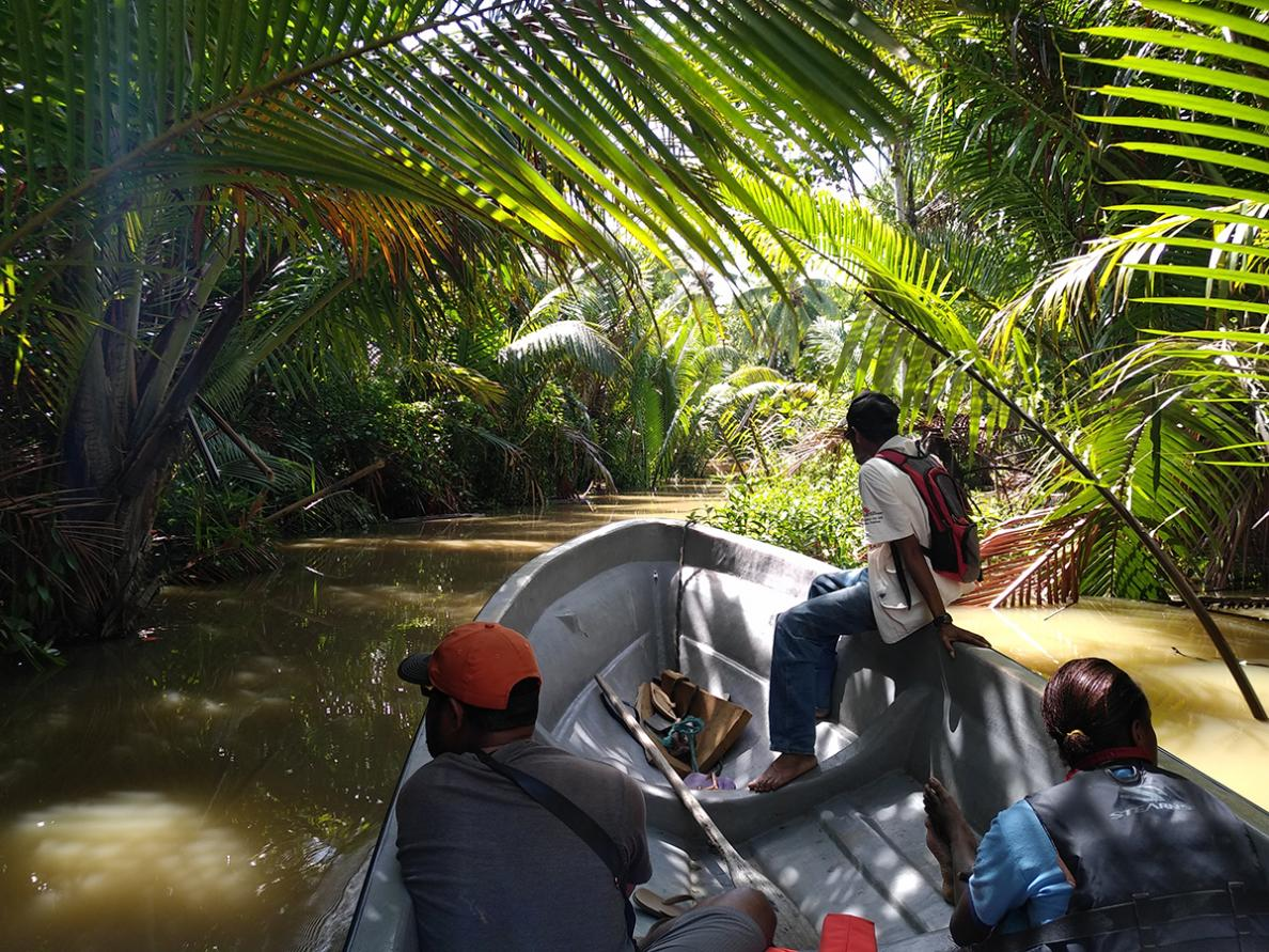 Nurse Aurelie and the team take a boat along the river in Papua New Guinea