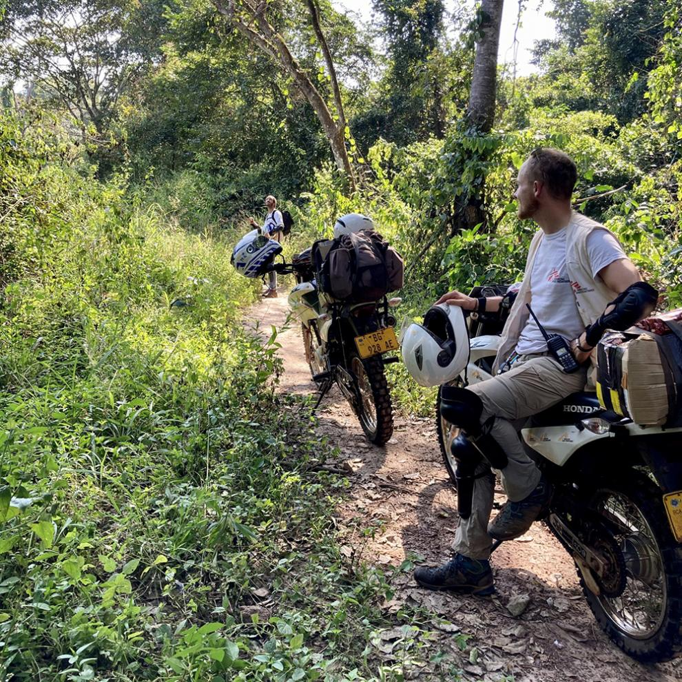 Dale and motorbike in the bush in Central African Republic