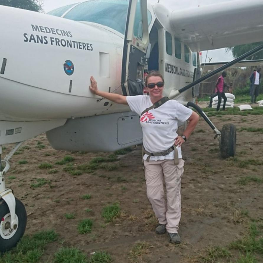 Melissa beside a small MSF plane
