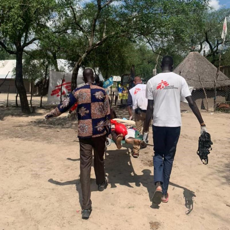 MSF staff transport a gunshot-wounded patient in Pieri, South Sudan