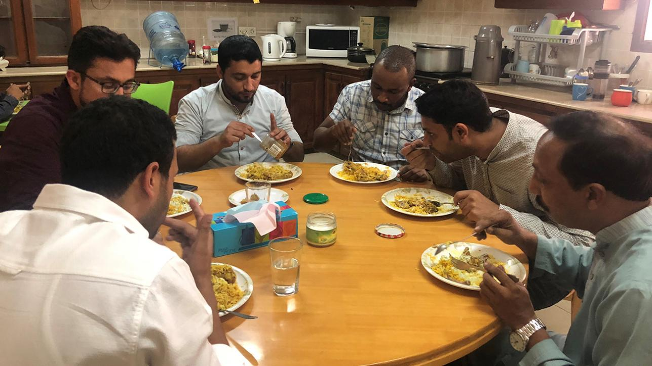 The MSF team share some delicious biryani at the office in Karachi