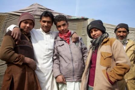 Young men from a camp in Kabul gather for a photo after helping to setup a temporary clinic for their people in Kabul.