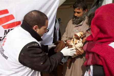 MSF doctor Nicos sees to a young patient at a temporary clinic in Kabul.