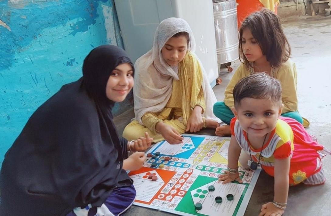 Children play the COVID-19 ludo game