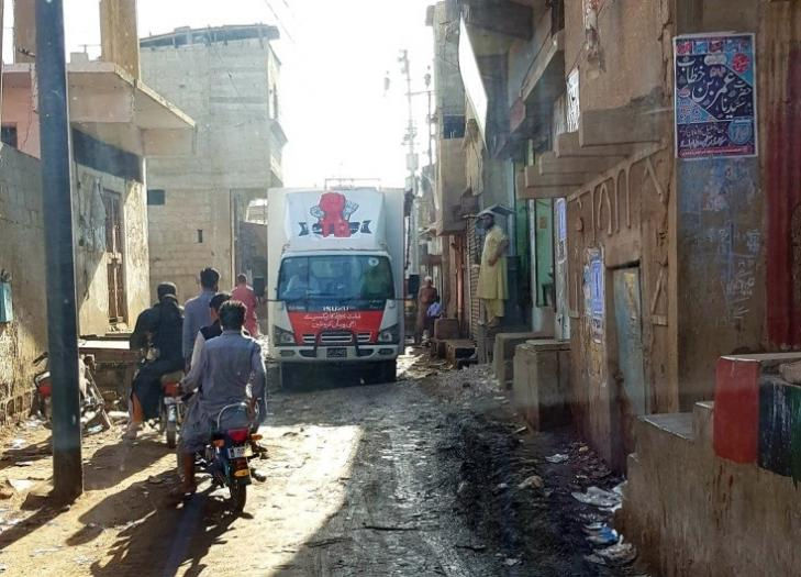 The TB van travelling through the narrow streets of Machar