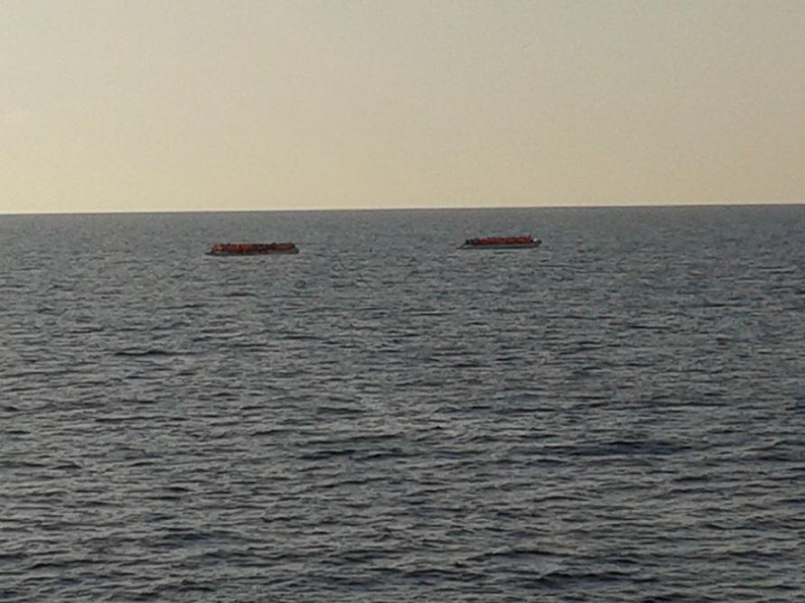 Two small boats awaiting rescue