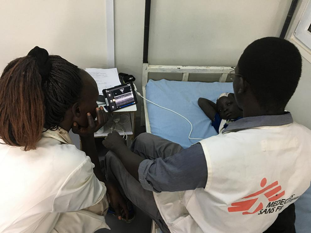A patient receives an ultrasound scan in Malakal