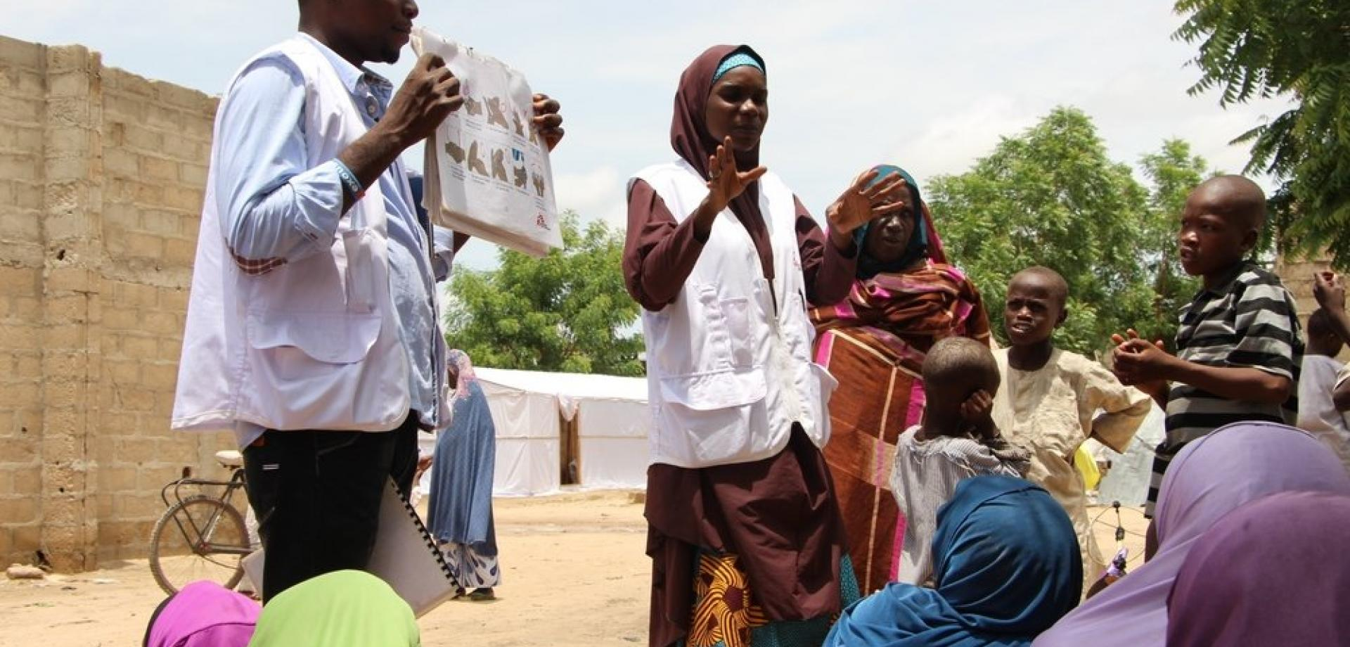 Health promotion staff speaking to displaced people in Borno State