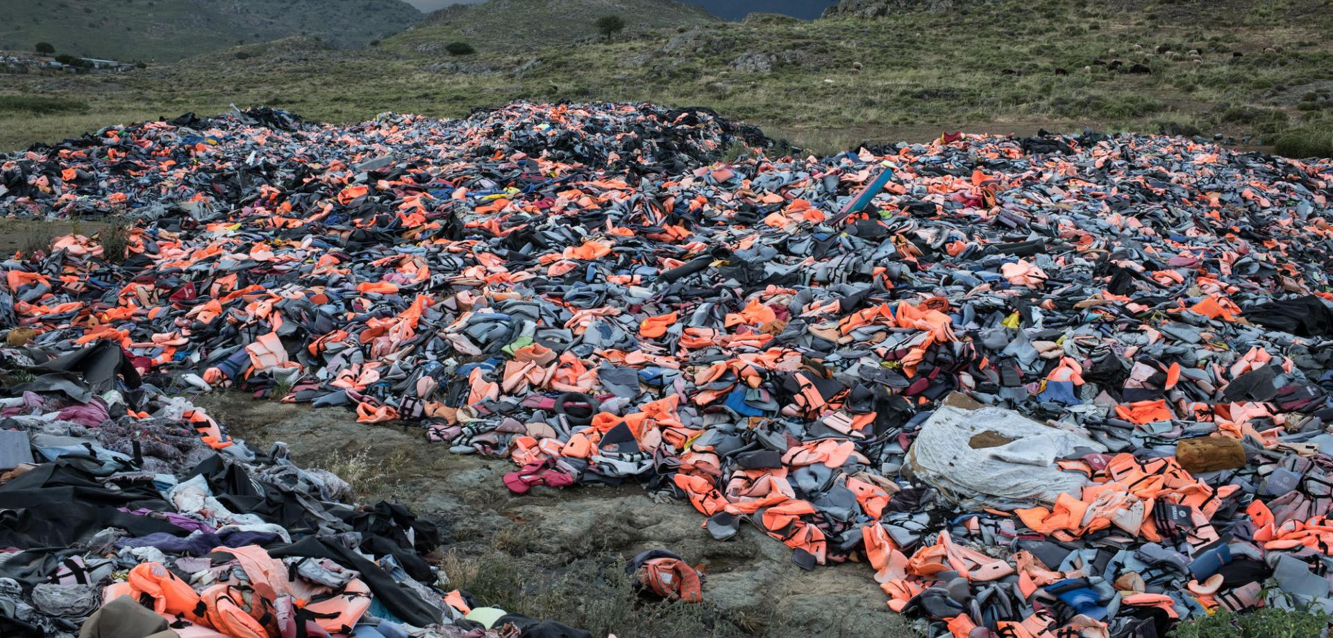 Thousands of life jackets left behind by arriving migrants and refugees, gathered at a dump on the island of Lesvos.