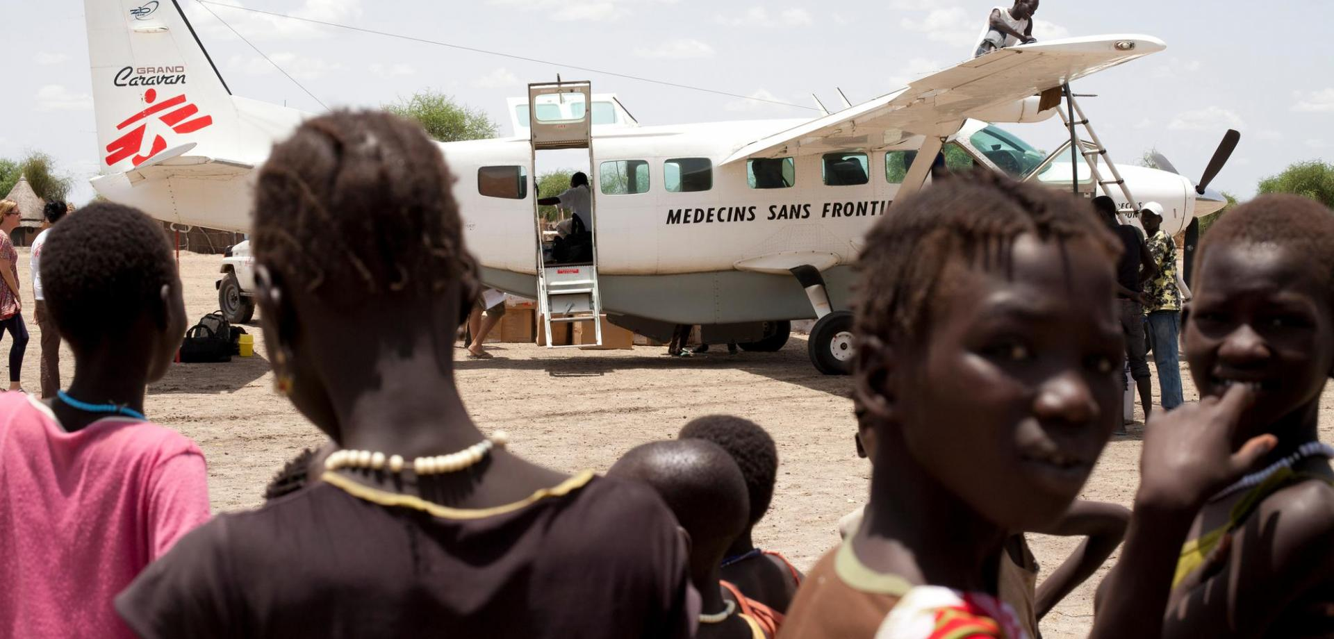 MSF logisticians unload supplies delivered by plane to Lankien, South Sudan. Isolated and difficult to reach by road, the project is often supplied by air.