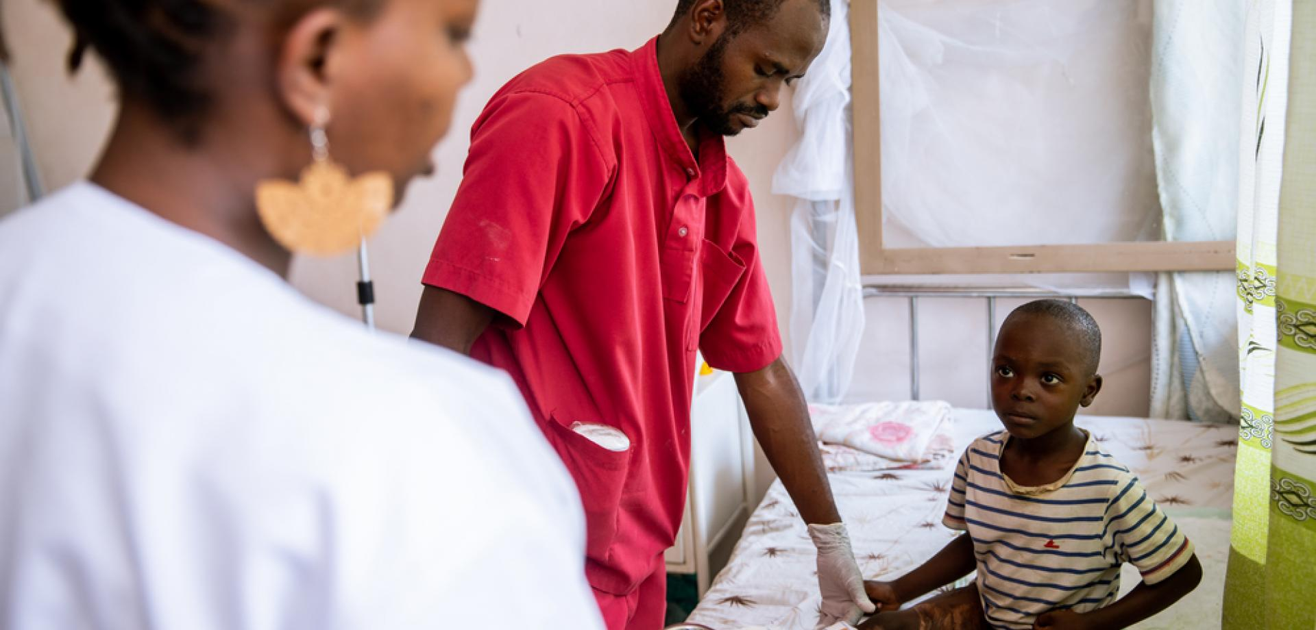 A child is treated for second degree burns at the L'Arche de Kigobe trauma centre
