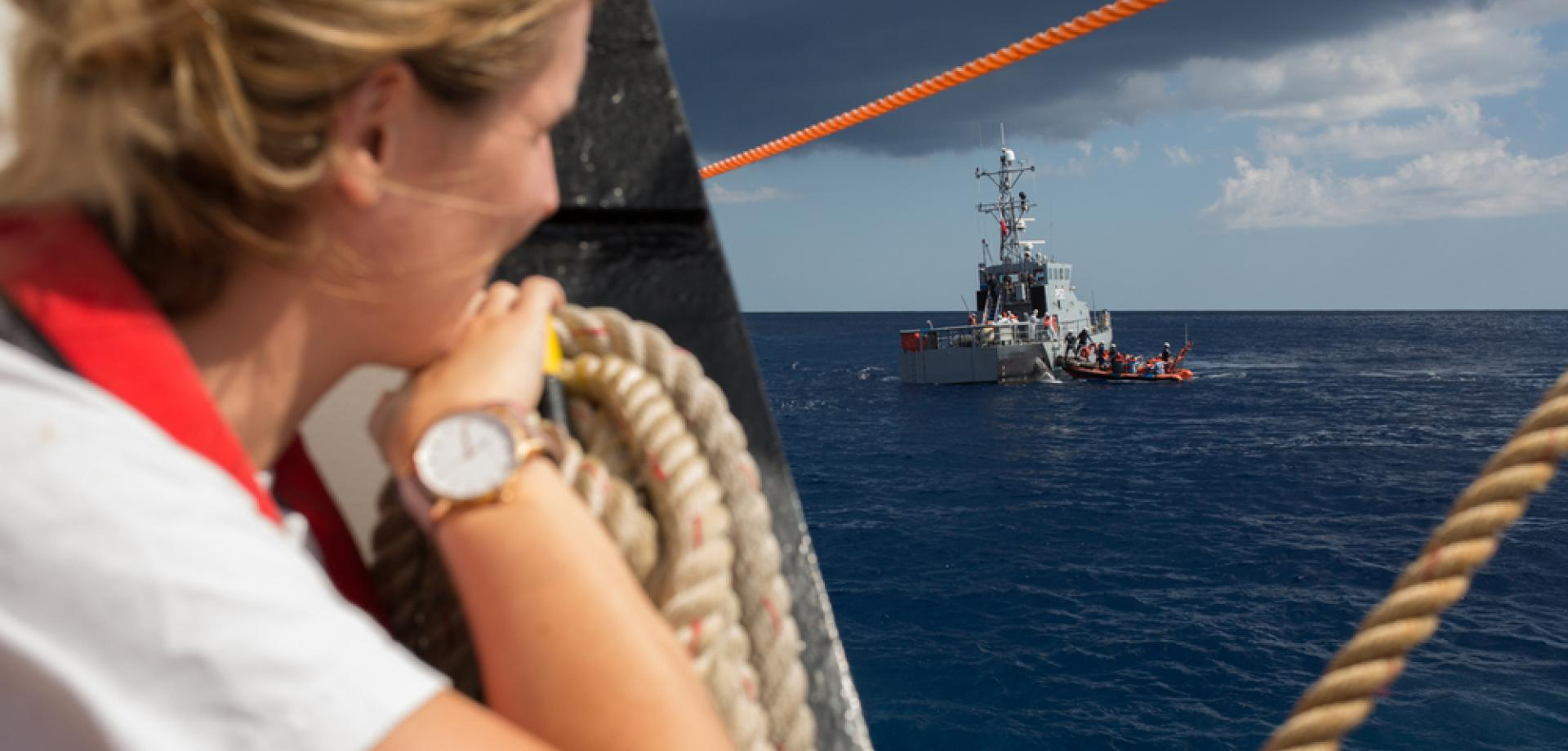 MSF nurse Catherine Flanigan watches on as survivors are transferred from Aquarius to Maltese authorities