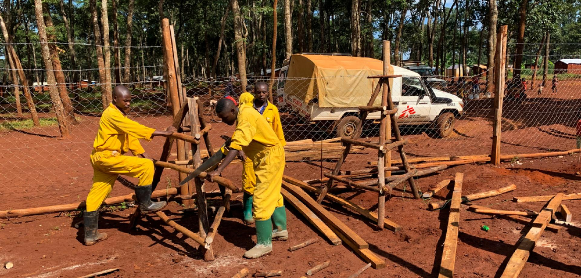 Workers build a temporary triage and isolation area as MSF steps up preparedness measures for COVID-19 at Nduta refugee camp in northwest Tanzania.