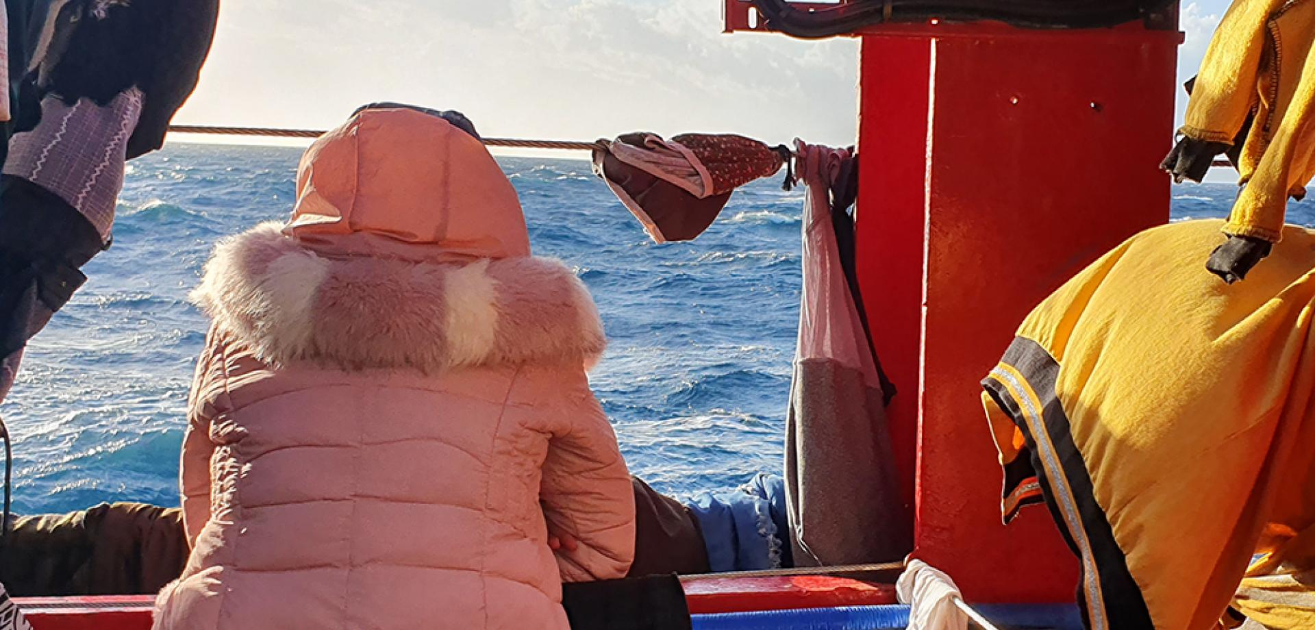 A Somali woman looks out to sea after being rescued by MSF and SOS MEDITERRANEE
