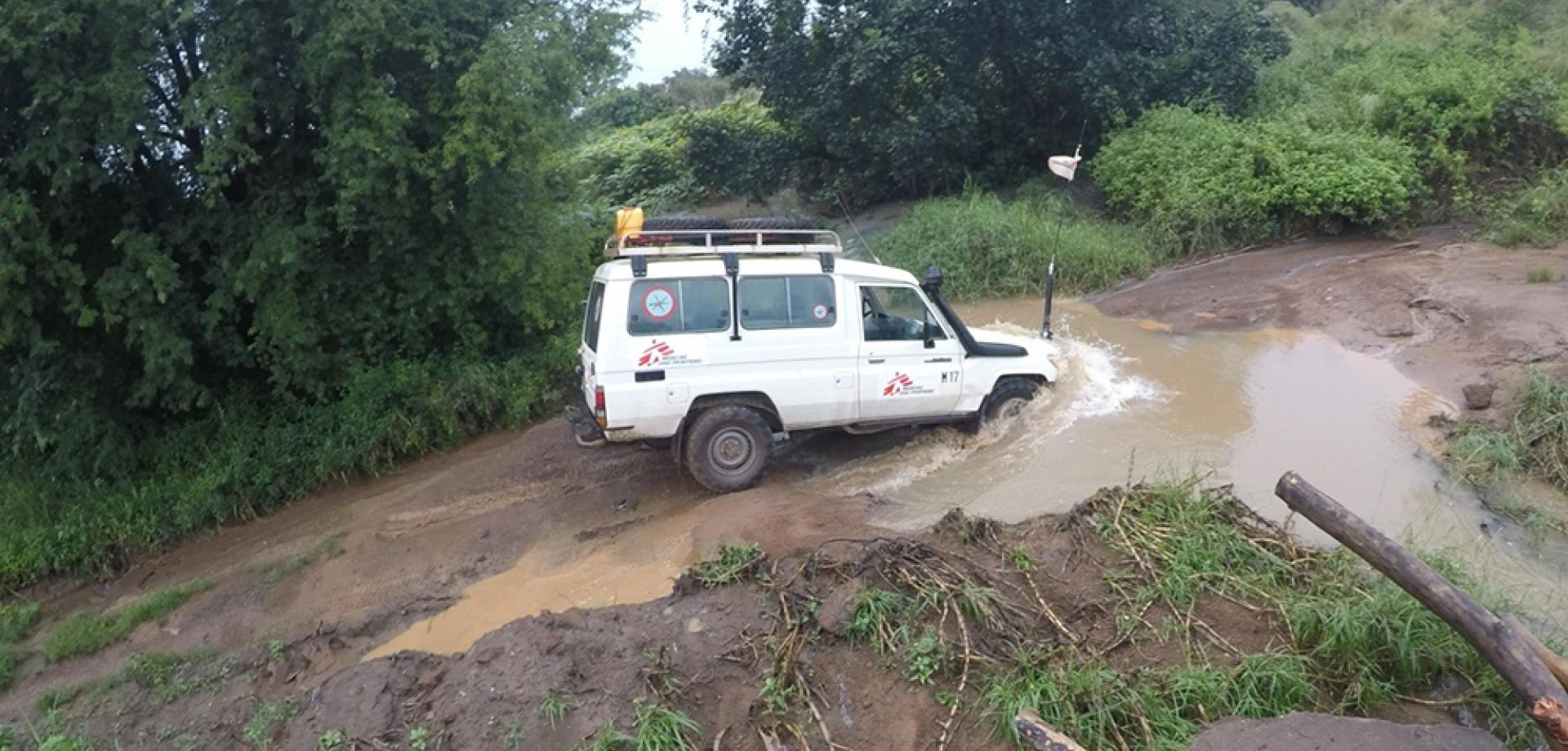 An MSF landcruiser driving through a river in CAR