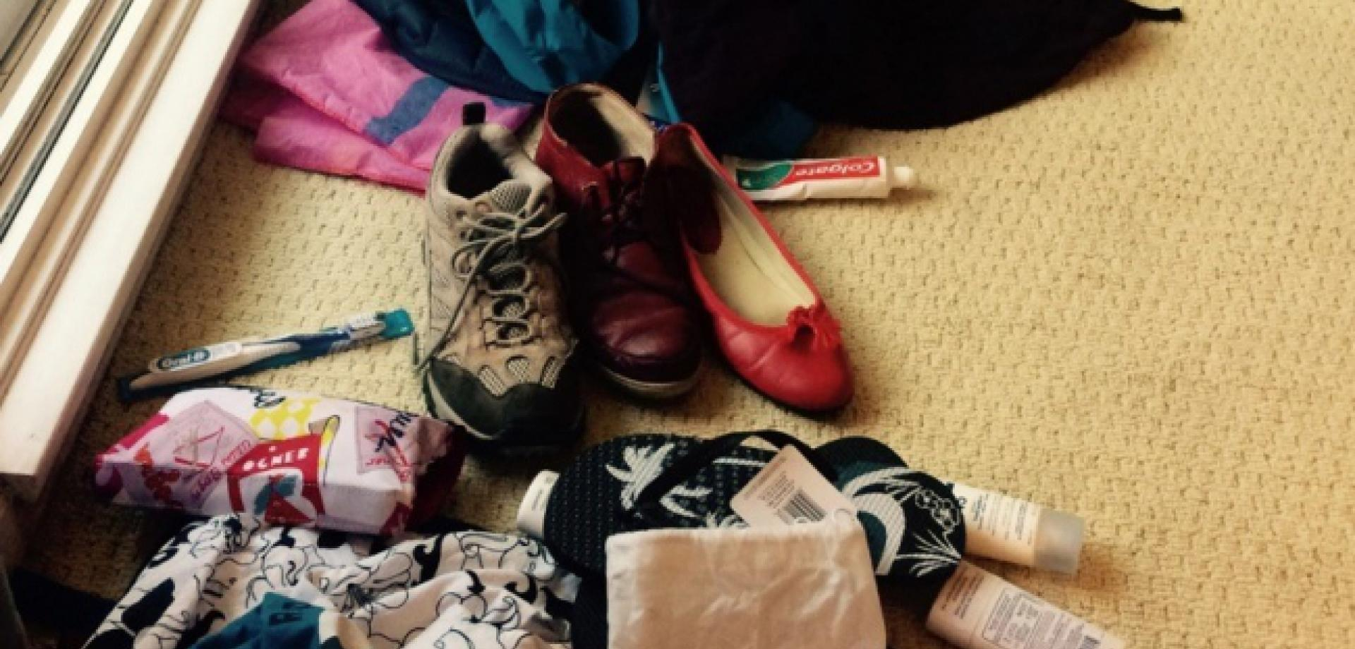 Hilary's packing scattered on the floor