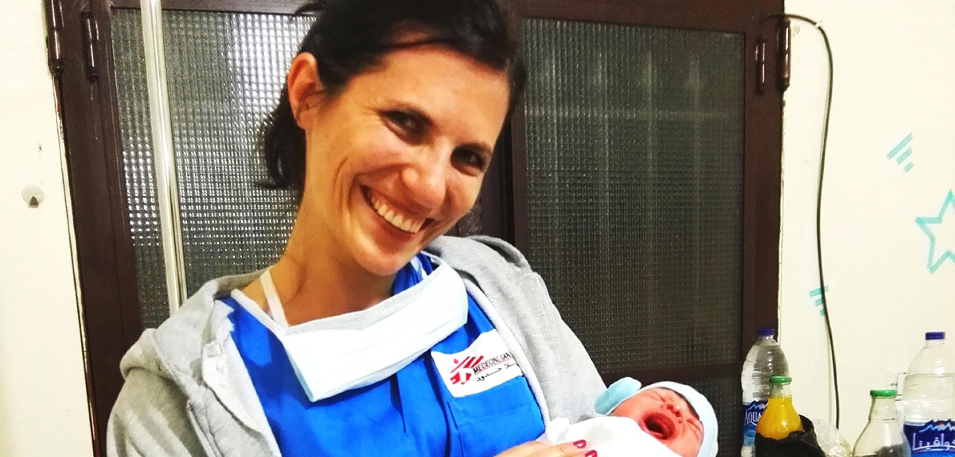 Nicole Bachtold holds a newborn baby