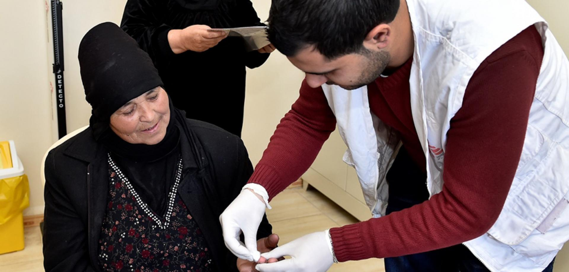 A nurse attends to a patient in Lebanon