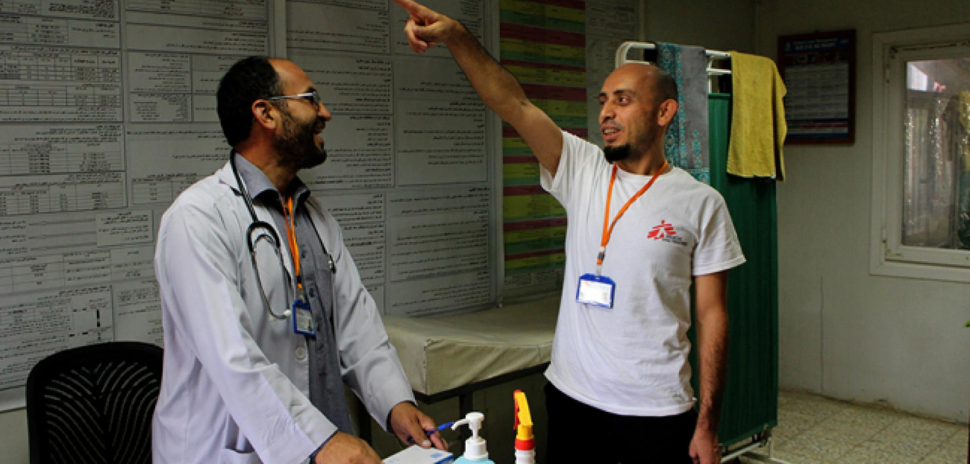 Sleiman and a colleague at Ahmed Shah Baba hospital.